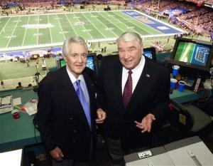 In this 2002 file photo, Fox broadcasters Pat Summerall, left, and John Madden stand in the FOX broadcast booth at the Louisiana Superdome before  Super Bowl XXXVI.