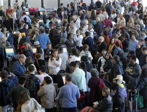 Passengers gather at the American Airlines check-in for flights at Los Angeles International Airport on Tuesday.