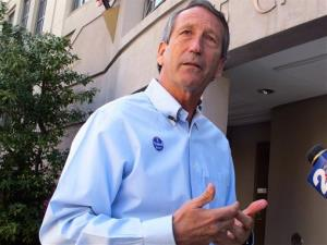Former South Carolina Gov. Mark Sanford answers questions from reporters in Charleston earlier this month.