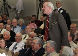 State Rep. Peter Hansen yells out from his seat during debate on a bill to repeal gay marriage at the statehouse, Wednesday, March 21, 2012 in Concord, NH.