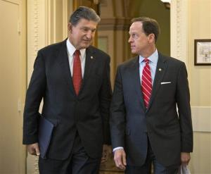 A file photo of Sen. Joe Manchin, D-W.Va., left, and Sen. Patrick Toomey, R-Pa.