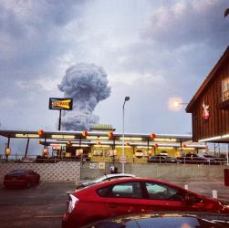 In this Instagram photo provided by Andy Bartee, a plume of smoke rises from a fertilizer plant fire in West, Texas.