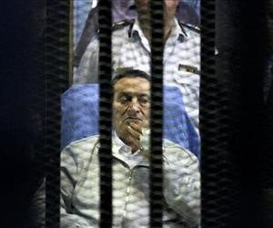 Egypt's deposed President Hosni Mubarak attends a hearing session in his retrial on appeal in Cairo, Egypt, Monday, April 15, 2013.