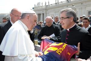 Mons. Miguel Delgado Galindo presents a jersey of Argentine soccer star Lionel Messi to Pope Francis, at the Vatican Wednesday, April 17, 2013.