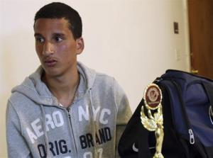 Salah Eddin Barhoum sits in his apartment in Revere, Mass., Thursday.