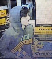 This surveillance photo released via Twitter Friday, April 19, 2013 by the Boston Police Department shows a suspect entering a convenience store that police are pursuing in Watertown, Mass.