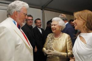 Queen Elizabeth II meets Rolf Harris and Kylie Minogue backstage at The Diamond Jubilee Concert in London Monday, June 4, 2012.