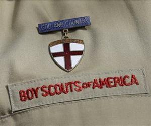 This photo taken Monday, Feb. 4, 2013, shows a Boy Scout uniform worn by Brad Hankins, a campaign director for Scouts for Equality, as he responds questions during a news conference in Irving, Texas.