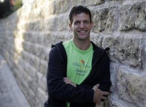 Marathon runner Joe Berti poses for a photo in Austin, Texas, Thursday.