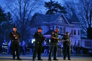 Police officers guard the entrance to Franklin street, where the standoff is taking place.