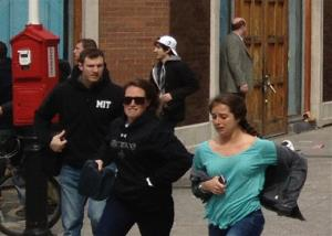 That's Dzhokhar A. Tsarnaev, in white hat, moving away from the scene of one of the explosions.