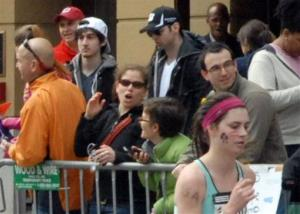 This April 15 photo provided by Bob Leonard shows the  Tsarnaev brothers (white hat and black hat) in the crowd at the Boston Marathon. It was taken 10 to 15 minutes before the first blast.