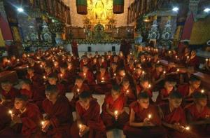 Young Buddhist monks in India pray for the speedy recovery of a 5-year-old girl who was assaulted.