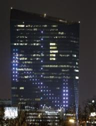 The classic Atari video game Pong is played on the facade of the Cira Center in Philadelphia on Friday. Players controlled the action from afar.