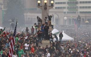 Members of a crowd numbering tens of thousands smoke marijuana and listen to live music, at the Denver 420 pro-marijuana rally at Civic Center Park in Denver on Saturday, April 20, 2013.
