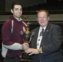 In this Feb. 17, 2010, photo, Tamerlan Tsarnaev, left, accepts the trophy for winning the 2010 New England Golden Gloves Championship from Dr. Joseph Downes, right, in Lowell, Mass.