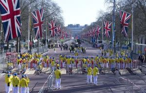 Volunteers in bright yellow get ready prior to the London Marathon in the Mall in London, Sunday, April  21, 2013.