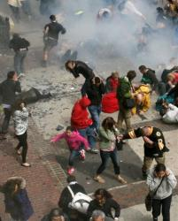 People react to an explosion at the 2013 Boston Marathon in Boston.