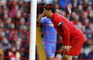Liverpool's Luis Suarez after he appeared to bite Chelsea's Branislav Ivanovic during the English Premier League match at Anfield, Liverpool, England.