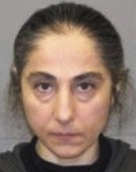 This June 2012 booking photo released by the Natick, Mass., police shows Zubeidat K. Tsarnaeva, mother of Tamerlan and Dzhokhar Tsarnaev.