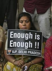 An Indian woman holds a placard during a protest to demand for tougher rape laws and better police protection for women, outside the Parliament in New Delhi, India, Monday, April 22, 2013.