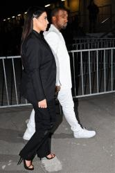 Kim Kardashian and Kanye West arrive at Givenchy's Ready to Wear's Fall-Winter 2013-2014 fashion collection presented Sunday, March 3, 2013 in Paris.