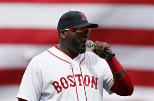 Boston Red Sox's David Ortiz speaks to the crowd before a baseball against the Kansas City Royals in Boston, Saturday, April 20, 2013.