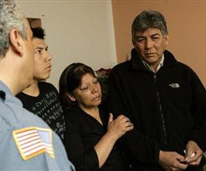 The family of Sgt. Christian Bueno-Galdos, who was among those gunned down by a John Russell in a clinic in Iraq, receive condolences at their New Jersey home in this May 13, 2009 file photo.