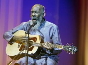 FILE - In this May 1, 2008 file photo, Richie Havens plays at the opening night ceremony during the 61st International film festival in Cannes, southern France. Havens, who sang and strummed for a sea of people at Woodstock, has died at 72. His family says in a statement that...