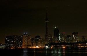 The skyline of Toronto's downtown is dimmed as many of the lights are turned off for Earth Hour on Saturday, March 28, 2009.