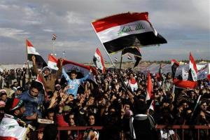 In this Wednesday, Jan. 9, 2013 file photo, protesters chant slogans against Iraq's Shiite-led government as they wave national flags during a demonstration in Ramadi, 70 miles west of Baghdad, Iraq.
