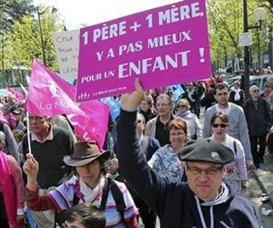 Demonstrators march during a rally to protest against French President Francois Hollande's social reform on gay marriage and adoption in Paris, Sunday, April 21, 2013.