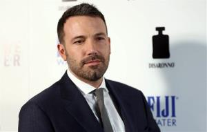 In this Tuesday, April 9, 2013 publicity photo provided by Fiji Water, actor Ben Affleck arrives at the premiere of To The Wonder hosted by FIJI Water, in Los Angeles.