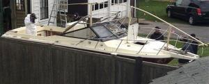Investigators go over Henneberry's boat.
