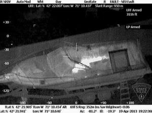 This Friday, April 19, 2013 image shows 19-year-old Boston Marathon bombing suspect Dzhokhar Tsarnaev hiding inside a boat during a search for him in Watertown, Mass.