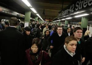 Morning commuters fill the platform as they exit a train in New York's Times Square subway station,  Thursday, March 14, 2013.