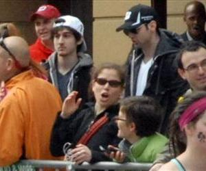 This Monday, April 15, 2013 photo shows bombing suspects Tamerlan Tsarnaev, 26, and his brother, Dzhokhar Tsarnaev, 19, approximately 10-20 minutes before the blasts that struck the Boston Marathon.