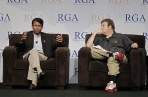 In this file photo, Louisiana Gov. Bobby Jindal, left, speaks as political consultant Frank Luntz listens at a conference in 2011.