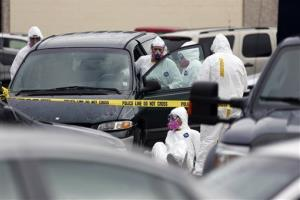 Federal agents inspect the Dodge Grand Caravan driven by Everett Dutschke near the site of a martial arts studio he once operated, Wednesday, April 24, 2013 in Tupelo, Miss.