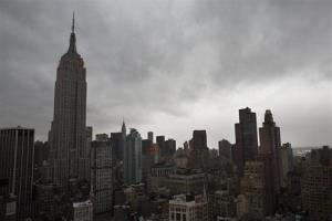 Storm clouds loom over the Empire State Building and Manhattan skyline.