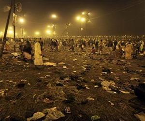 Shoes and other belonging discarded by Hindu devotees are seen strewn across the ground at 'Sangam', the confluence of Hindu holy rivers Ganges, Yamuna and the mythical Saraswati.