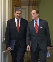 Sen. Joe Manchin of West Virginia, D-W.Va., left, and Sen. Patrick Toomey, R-Pa., in a photo from April 10.