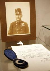 A lock of hair from Austrian Emperor Franz Josef, pictured in background  on display, at an auction house  in Vienna.