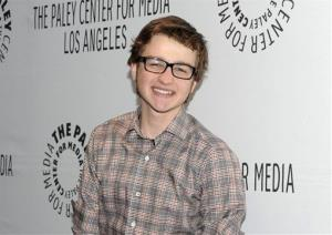 In this March 12, 2012 file photo, actor Angus T. Jones arrives at the Paleyfest panel discussion of the television series Two and a Half Men in Beverly Hills, Calif.