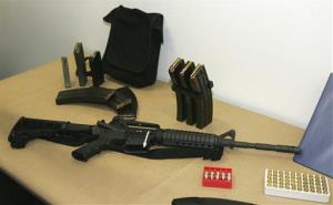 File photo of a Bushmaster AR-15 semi-automatic rifle and ammunition.