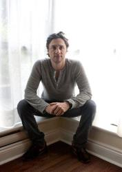 Zach Braff  poses for a photo as he promotes his new film The High Cost of Living at the Toronto International Film Festival in Toronto on Tuesday, Sept. 14, 2010.