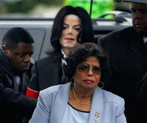 In this Monday, Feb. 28, 2005 file photo, Michael Jackson follows his mother, Katherine Jackson, as they arrive for court on the opening day of his child molestation trial.