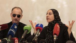The mother of the two Boston bombing suspects, Zubeidat Tsarnaeva, with the suspects' father Anzor Tsarnaev, left, speaks at a news conference in Makhachkala, Dagestan, Thursday, April 25, 2013.