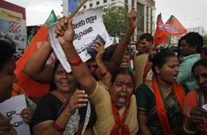 Women activists of India's main opposition Bharatiya Janata Party shout slogans during a protest against the rape of a 5-year-old girl in New Delhi, in Hyderabad, India, Tuesday, April 23, 2013.