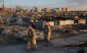 New Orleans firefighters tour the Breezy Point section of Queens, NY, Wednesday, Nov. 28, 2012.